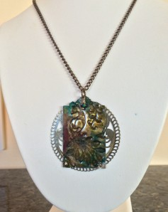 Peacock Dance Necklace Hues of teal, raspberry, and jade highlight this peacock, framed by a lovely piece of Indian metalwork.
