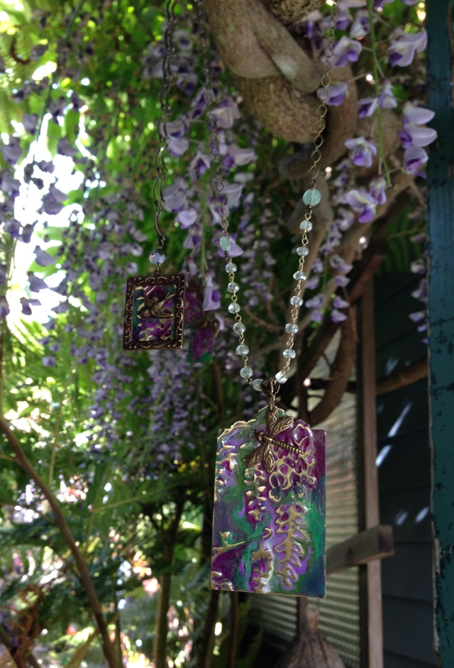Fireflies and birds wing their way through the painted and real lavender and amethyst blooms