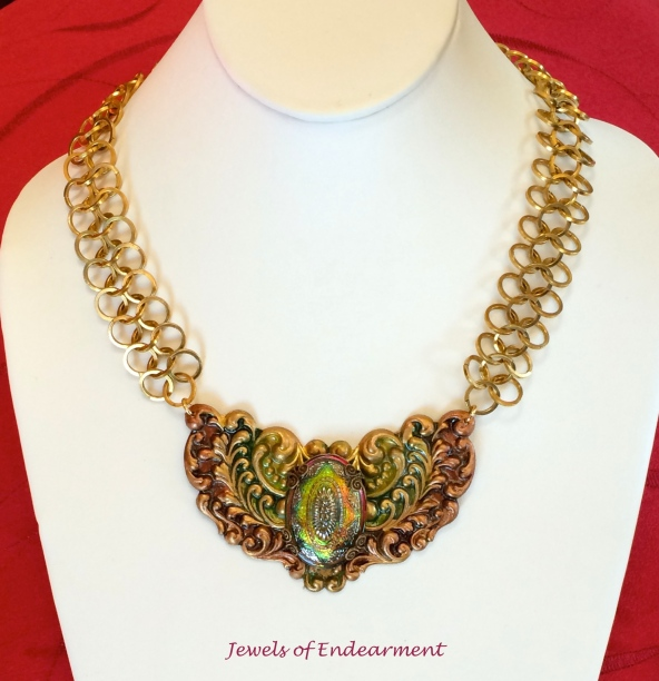 Radiant Emerald and Wine Necklace The rich palette of this glowing Czech glass deserved equally sumptuous hues to complement it. The chain is handmade with squared rings.