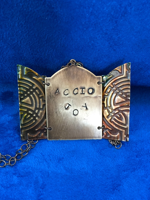 Accio Joy Doorway Necklace Open the door to joy with a hand tinted and embellished necklace